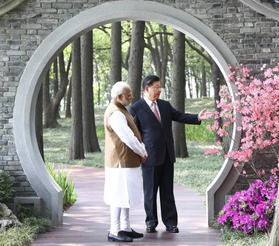 WUHAN: In this photo released by China's Xinhua News Agency, Indian Prime Minister Narendra Modi, left, and Chinese President Xi Jinping talk at a garden in Wuhan in central China's Hubei Province, Saturday, April 28, 2018. The leaders of China and India