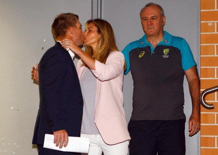 Former Australian cricket vice-captain David Warner kisses his wife Candice. AP/PTI