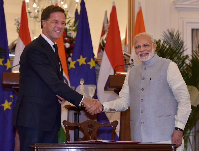 Prime Minister Narendra Modi shakes hands with Netherlands Prime Minister Mark Rutte after signing 'International Solar Alliance' agreement at Hyderabad House, in New Delhi, on Thursday. PTI