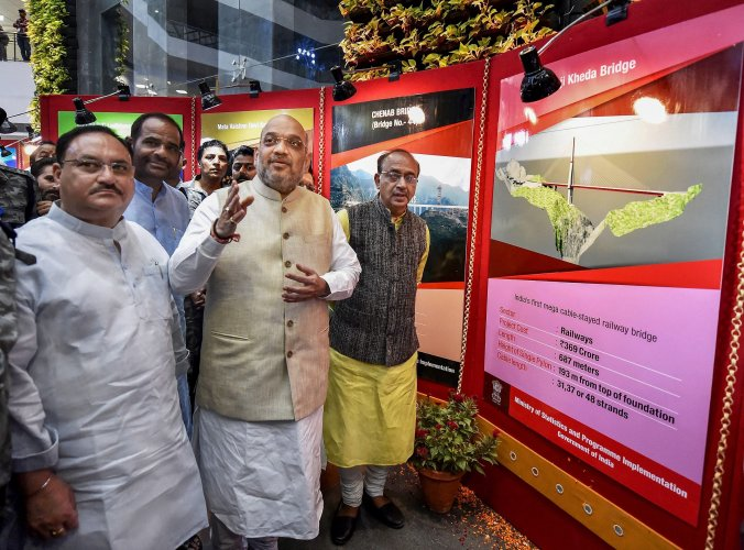 BJP president Amit Shah with Union Minister of Parliamentary Affairs and Statistics Vijay Goel and Union Health Minister J P Nadda inaugurates a photo exhibition on completion of 4 years of the NDA government, at Ambedkar International Centre, in New Delhi, on Friday. PTI