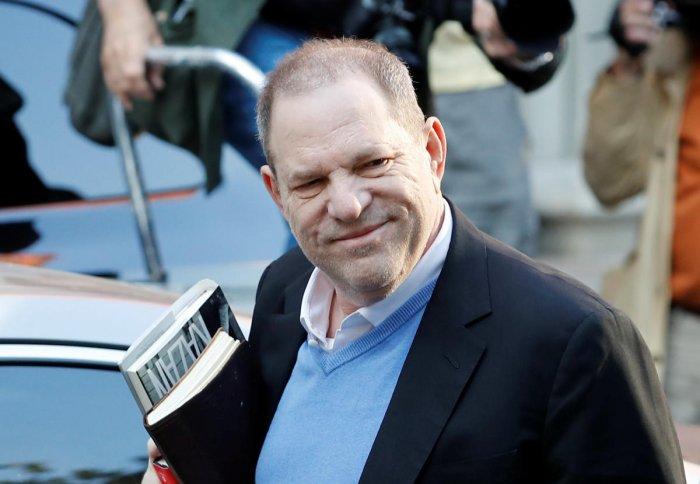 Film producer Harvey Weinstein arrives at the 1st Precinct in Manhattan in New York. Reuters Photo