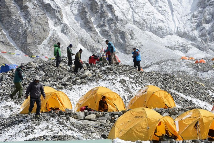 Sherpas prepare to pay respects to Mount Everest before beginning their climb. AFP