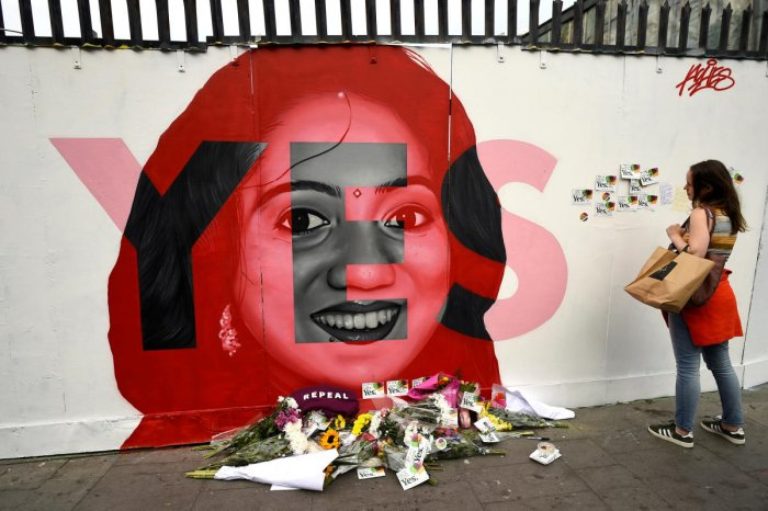 A woman looks at a new mural of Savita Halappanavar with flowers placed beneath it put up on the day of the Abortion Referendum on liberalising abortion laws in Dublin, Ireland May 25, 2018. REUTERS File photo