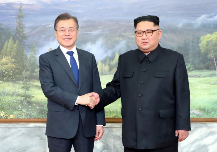 South Korean President Moon Jae-in shakes hands with North Korean leader Kim Jong Un during their summit at the truce village of Panmunjom, North Korea, in this handout picture provided by the Presidential Blue House on May 26, 2018. The Presidential Blue