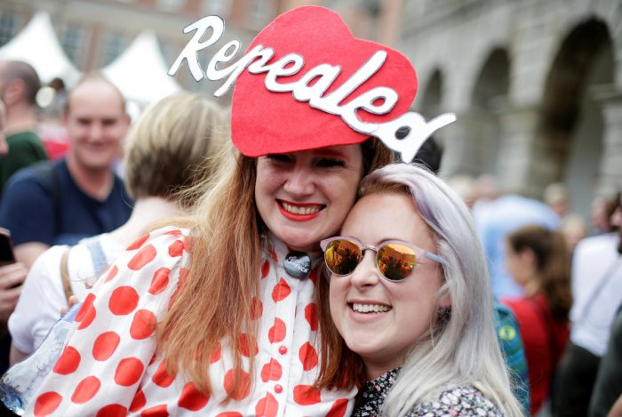 People celebrate the result of yesterday's referendum on liberalizing abortion law, in Dublin, Ireland, May 26, 2018. REUTERS/Max Rossi