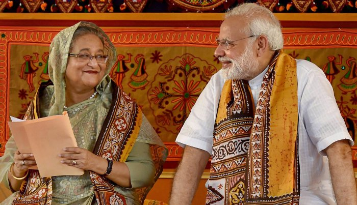 Prime Minister Narendra Modi speaks with his Bangladeshi counterpart Sheikh Hasina during the annual convocation of Visva Bharati University, in Birbhum, on Friday. PTI