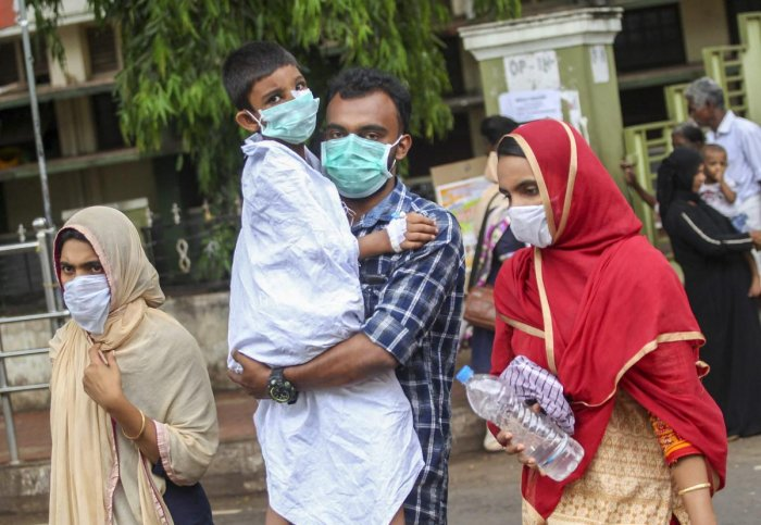 People wear safety masks as a precautionary measure after the 'Nipah' virus outbreak, at Kozhikode Medical College, in Kerala. PTI Photo
