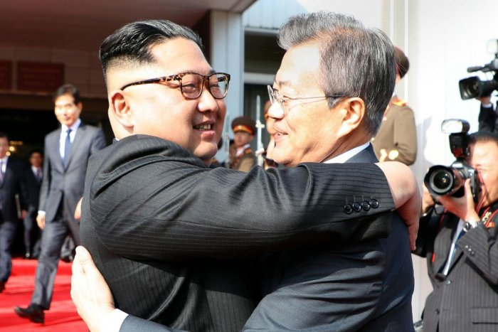 TOPSHOT - This picture taken on May 26, 2018 and released by the Blue House via Dong-A Ilbo shows South Korea's President Moon Jae-in (R) hugging North Korea's leader Kim Jong Un after their second summit at the north side of the truce village of Panmunjo