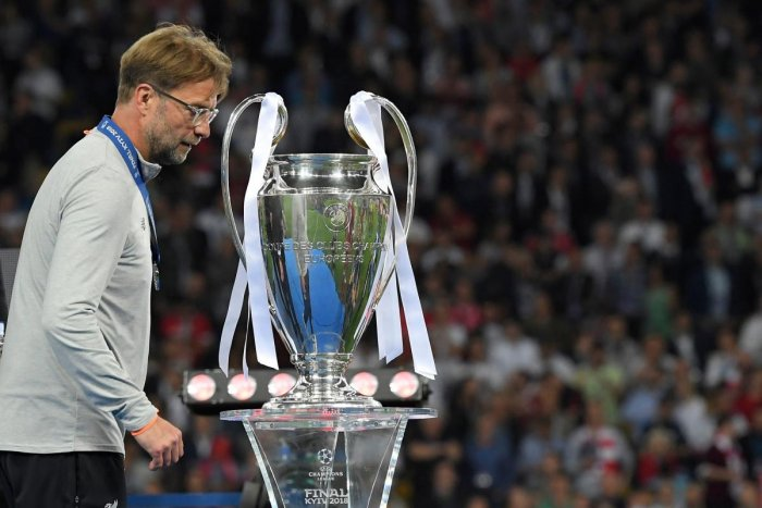 Liverpool's coach Jurgen Klopp walks past the trophy after the Champions League final.