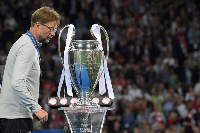 Liverpool's coach Jurgen Klopp walks past the trophy after the Champions League final.