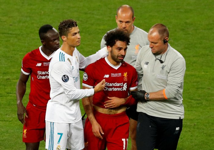 Cristiano Ronaldo consoles Mo Salah as he leaves the field in tears after suffering a shoulder injury. Reuters