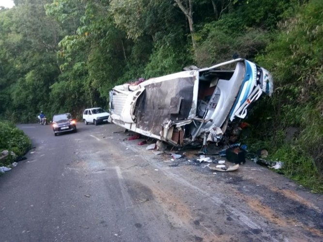 The mangled remains of the tourist bus that hit a boulder, near Gudalur in Tamil Nadu, on Saturday night.