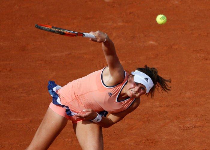Ukraine's Kateryna Kozlova serves during her first round match against Latvia's Jelena Ostapenko. REUTERS