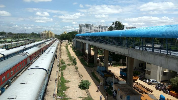 The walkway bridge connecting the city railway metro station with Krantivira Sangolli Rayanna railway station has been provided with shelter with the remaining civil work expected to be completed in a month. DH PHOTO