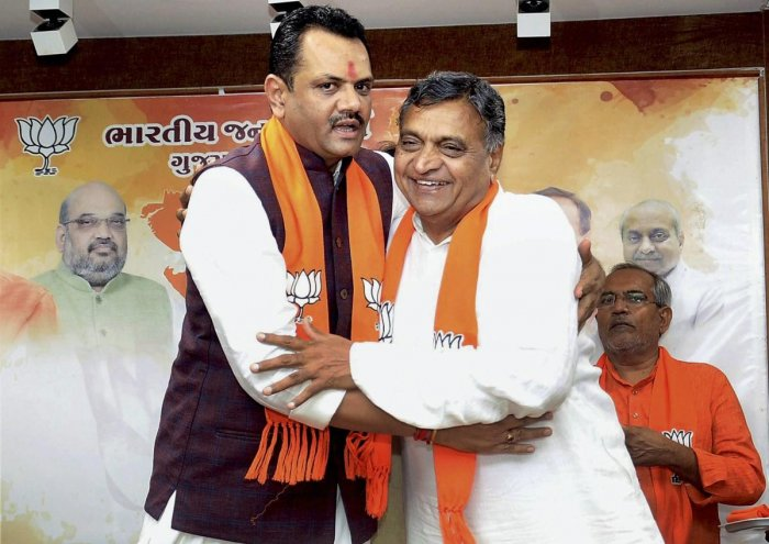 Gujarat BJP President Jitu Vaghani welcomes Congress MLA P I Patel as he joins BJP in Gandhinagar. PTI file photo.