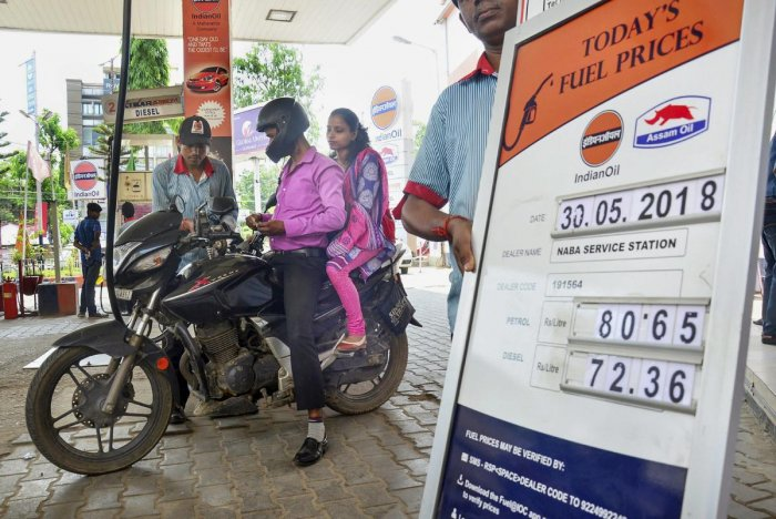 Guwahati: An employee attends a customer at a petrol pump, as the prices of petrol and diesel keep showing volatility, in Guwahati on Wednesday, May 30, 2018. (PTI Photo) (PTI5_30_2018_000031B)