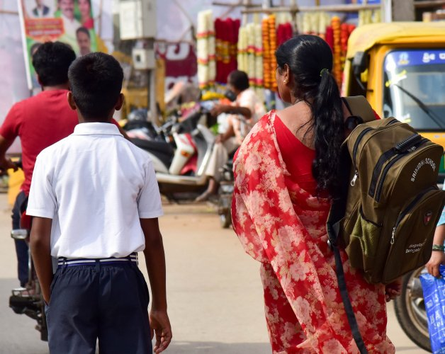 Heavy school bags alter the posture of the child and impact long-term health, doctors say. DH Photo by B H Shivakumar