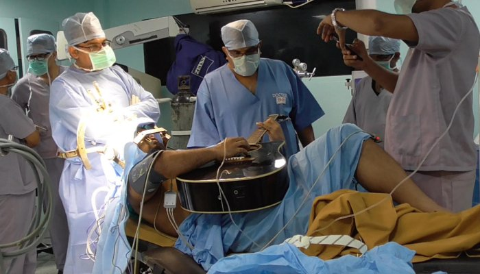 The 31-year-old Bangladeshi guitarist Taskin underwent the second such surgery in India, where he played the guitar as surgeons operated on him.