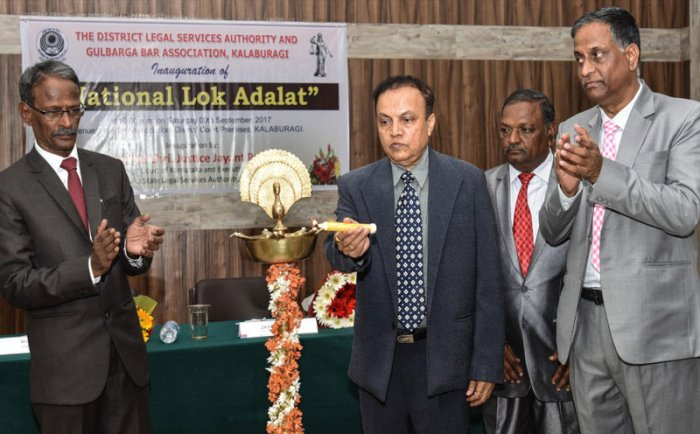 High Court Judge Justice Jayant Patel inaugurates National Lok Adalat, organised by District Legal Servises Authority and Gulbarga BAR Association at District Court in Kalaburgi on Saturday. Seen - Principal Sessions & DIstrict Judge B V Patil and President BAR Association R K Hiremat. DH File photo.