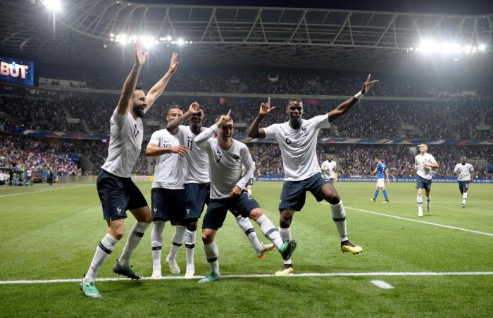 Clinical: France's Antoine Griezmann (centre) celebrates with team-mates after scoring against Italy in a friendly match on Friday. AFP