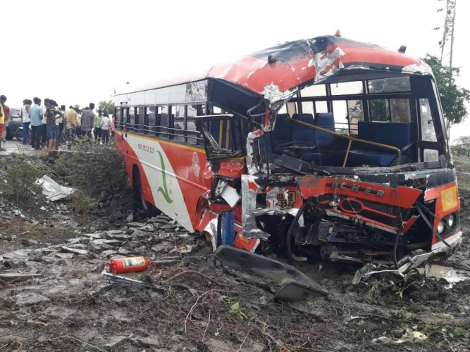 Mangled remains of a bus that was involved in the accident in Jevargi town in Kalaburagi district on Saturday