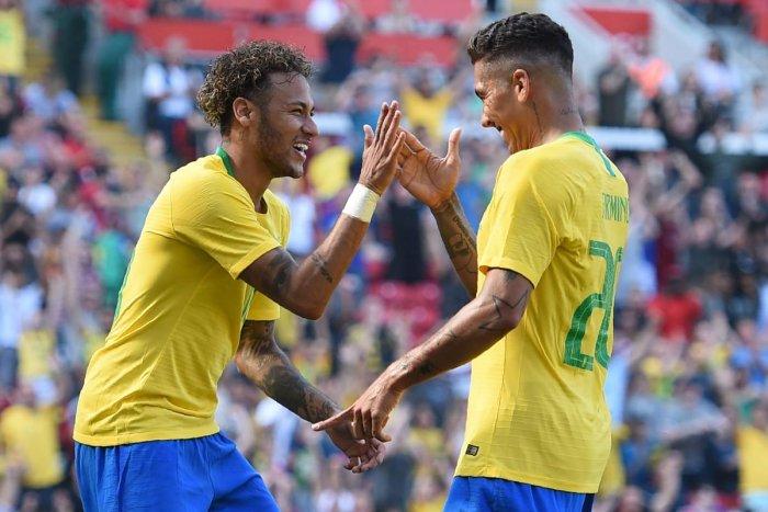 DANGEROUS DUO Brazil's Neymar (left) and Roberto Firmino celebrate the latter's goal against Croatia on Sunday. AFP