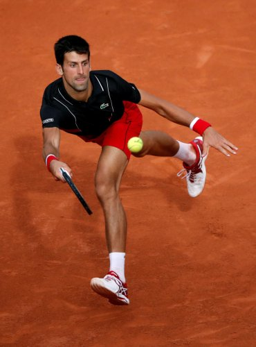 RESURGENT Serbia's Novak Djokovic returns during his fourth-round win over Spain's Fernando Verdasco on Sunday. REUTERS