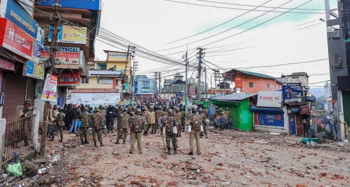 Securitymen stand guard a street during curfew in Shillong on Saturday. PTI file photo.