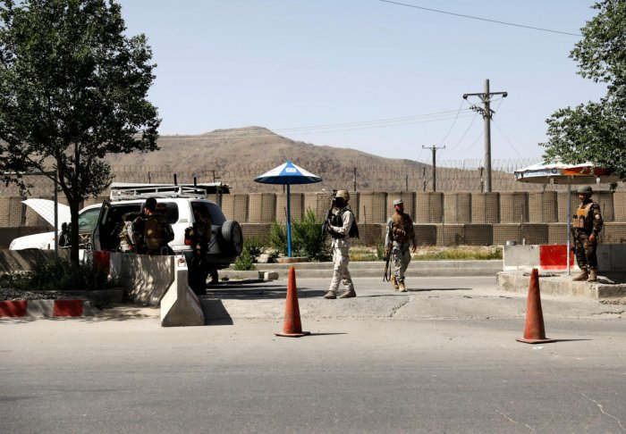 Afghan security forces inspect the at the gate of a Interior ministry after an attack in Kabul. Reuters photo.