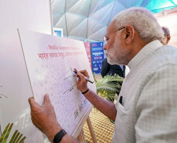 Prime Minister Narendra Modi visits the exhibition on the occasion of World Environment Day, in New Delhi on Tuesday. PTI