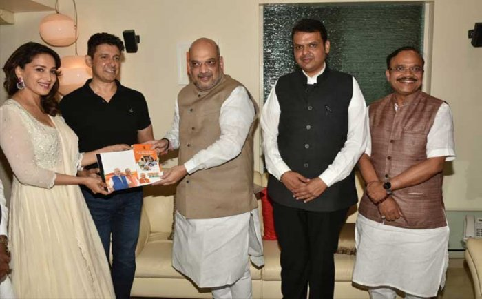 In picture: BJP president Amit Shah, actress Madhuri Dixit and Maharashtra Chief Minister Devendra Fadnavis.