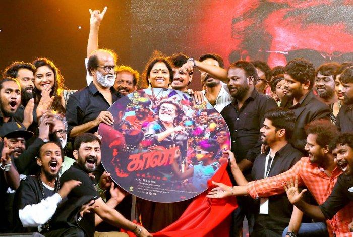 Actor Rajnikanth with crew members of his upcoming film 'Kaala'. PTI file photo