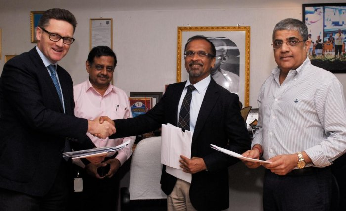 Mike Holland, CEO, Embassy Office Parks, with BMRCL managing director Mahendra Jain on Tuesday.