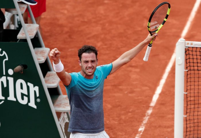 Italy's Marco Cecchinato celebrates winning his quarterfinal against Serbia's Novak Djokovic. REUTERS