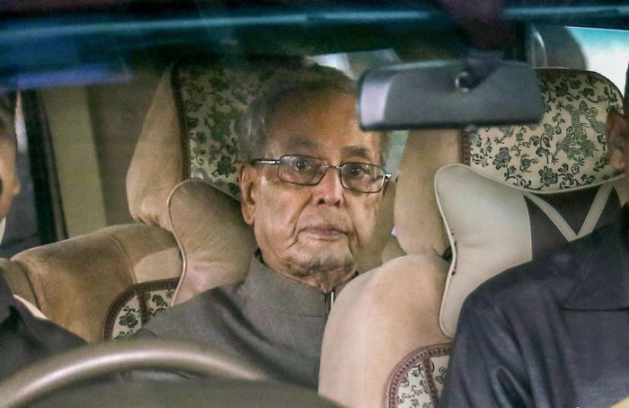 Former president Pranab Mukherjee arrives at Nagpur Airport, in Maharashtra on Wednesday. Mukherjee arrived to attend an RSS event on Thursday which has generated a lot of interest and controversy over the last few days. PTI Photo