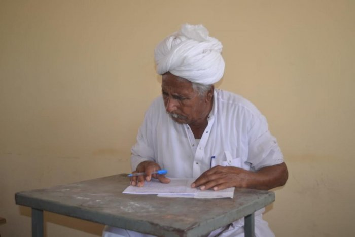 Andaram Jat, 82, appears for the class VIII examination at the Kota Open University in Barmer.