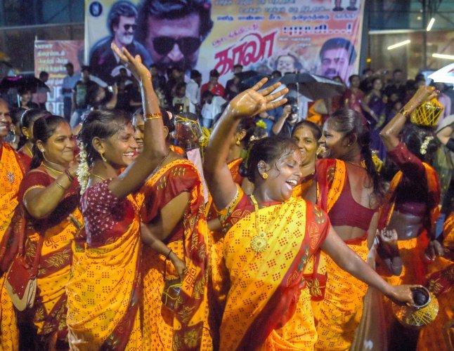 Rajinikanth fans celebrate the release of his film 'Kaala', in Mumbai on Thursday. PTI