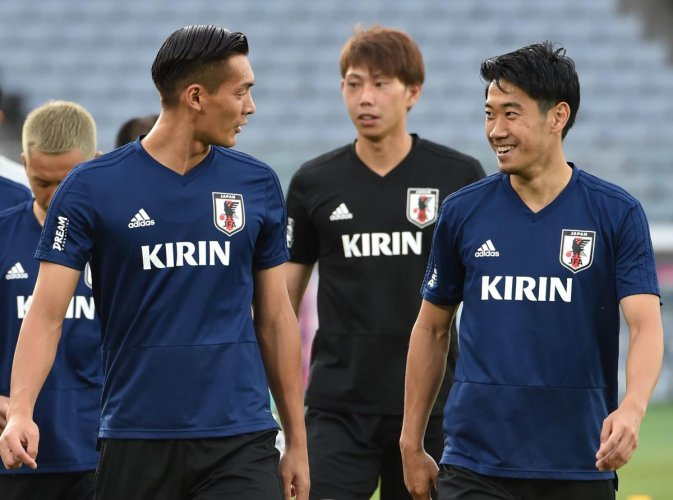 SEASONED WARHORSE Shinji Kagawa (right), who has rediscovered his form of old, will be the man Japan will be pinning most of their hopes on at the World Cup. AFP