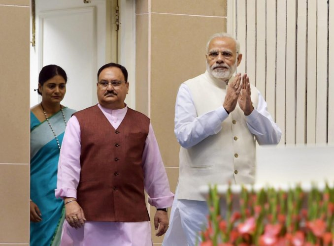 Prime Minister Narendra Modi with Health Minister JP Nadda. PTI file photo