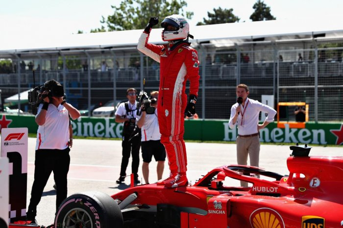 Ferrari's Sebastian Vettel celebrates after qualifying in pole for the Canadian Grand Prix. AFP