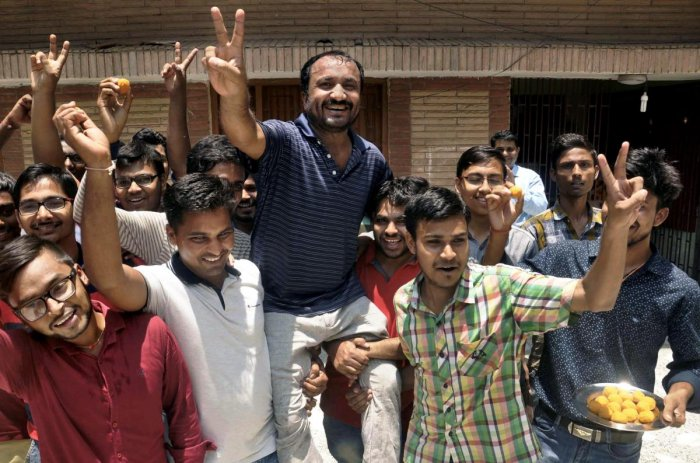Super 30 founder Anand Kumar and his students celebrate the result of IIT-JEE that was declared today, in Patna. PTI photo