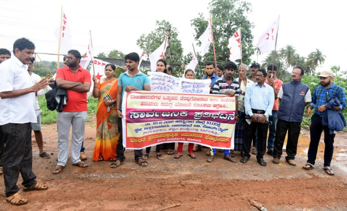 DYFI activists stage a protest at 4th Mile in Bangra Kuloor, Mangaluru, on Sunday.