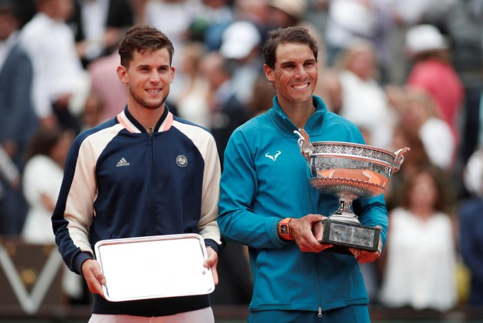 Spain's Rafael Nadal and Austria's Dominic Thiem pose for photographs with their trophies after the final. Reuters photo
