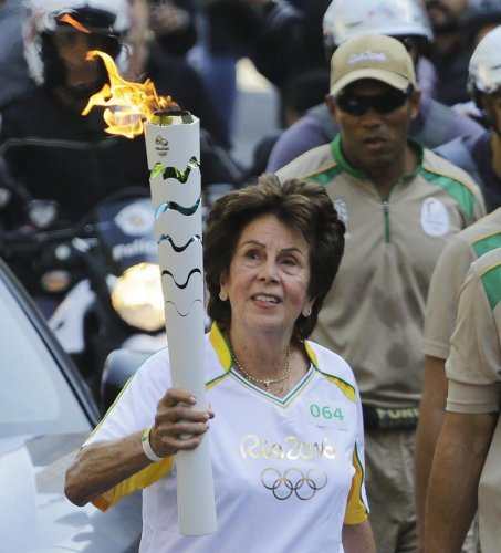 STYLE AND SUbSTANCE Maria Bueno with the Rio Olympic torch in Sao Paulo two years ago. Bueno, nicknamed 'The Tennis Ballerina', was one of the most elegant and successful players of her era. AP/ PTI