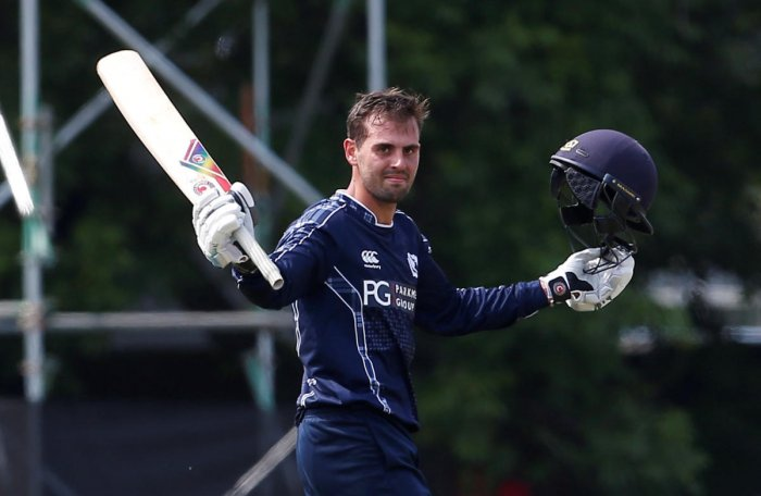 Scotland's Calum MacLeod celebrates scoring a century against England on Sunday. Reuters