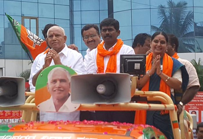 A DH file photo of BJP state president B S Yeddyurappa campaigning for RR Nagar party candidate Muniraju Gowda (centre) in Rajarajeswari Nagar constituency. Actor Shruti is also seen.