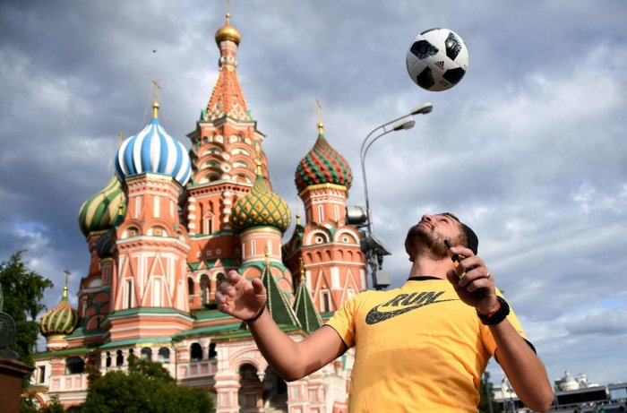 A man juggles with a ball in front of the St Basil's Cathedral on the Red Square in Moscow ahead of the World Cup. AFP
