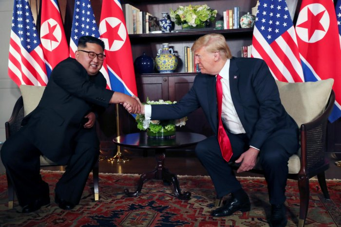 U S President Donald Trump shakes hands with North Korea's leader Kim Jong Un before their bilateral meeting at the Capella Hotel on Sentosa island in Singapore June 12, 2018. (REUTERS/Jonathan Ernst)