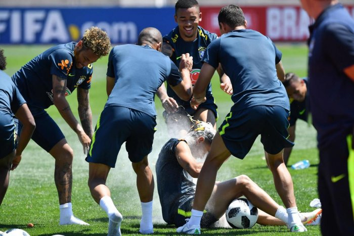 Brazil's national team players break an egg on the head of teammate Philippe Coutinho (centre) as they celebrate his birthday, during a training session in Sochi on Tuesday. AFP