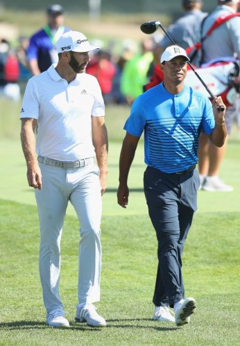 PERFECT WARM-UP World No 1 Dustin Johnson (left) walks along with legend Tiger Woods during Wednesday's practice round ahead of the US Open. AFP